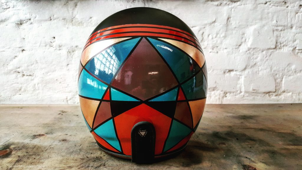 Graphic custom motorcycle helmet with copper